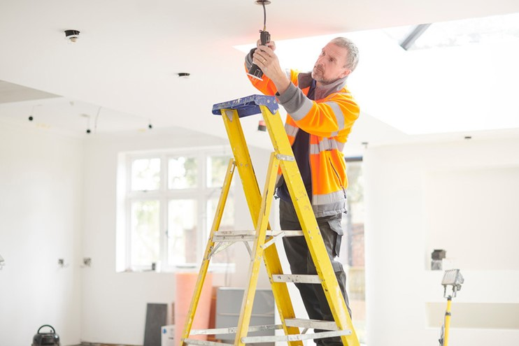 Man On Ladder Fixing Downlight